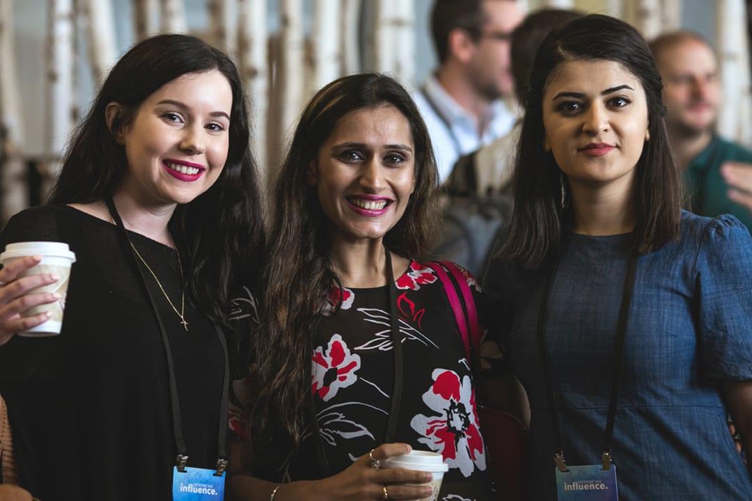 Three female attendees enjoy a coffee break during the 2018 Global Leadership Summit.